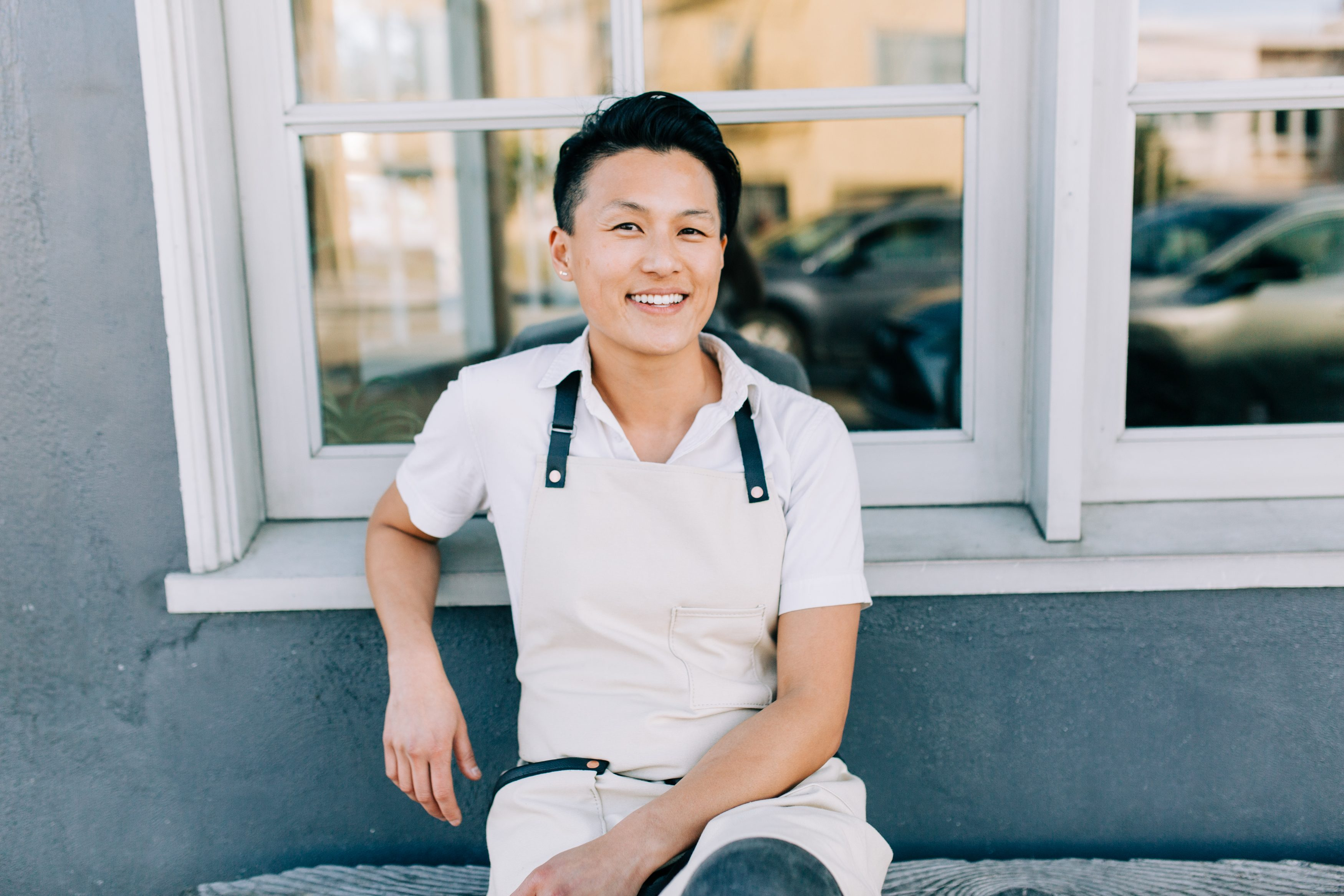 Chef Melissa's Picture, sitting in front a window smiling